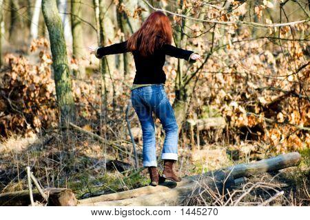 Woman Balancing On The Stump