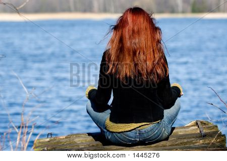 Woman Relaxing At The Lake