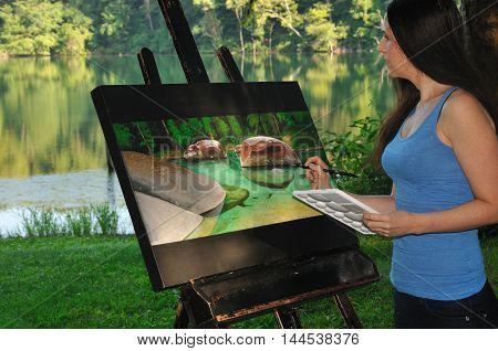 artist working on acrylic painting of nature scene outside by the water
