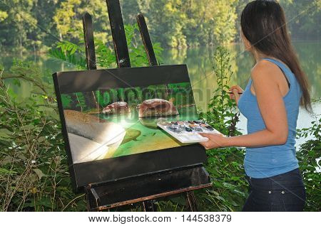 Female artist looking at the scenery while painting a nature scene on canvas