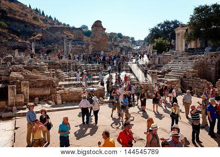 EPHESUS, TURKEY - SEPTEMBER 30, 2014: Tourists visiting Efes gathered under the Library of Celsus