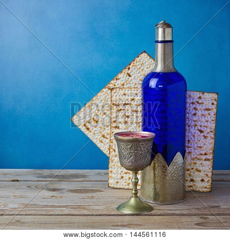 Jewish holiday Passover background with matzo and wine