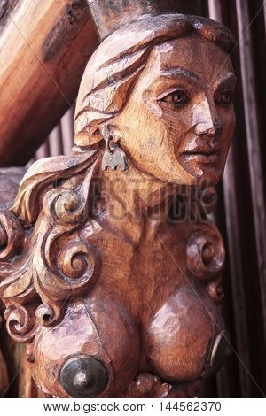 wooden figure of a naked siren in the bow of the ship