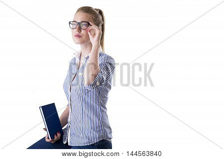Isolated portrait of nerd girl in striped shirt wearing glasses and holding book. Concept of woman engineer. Mock up