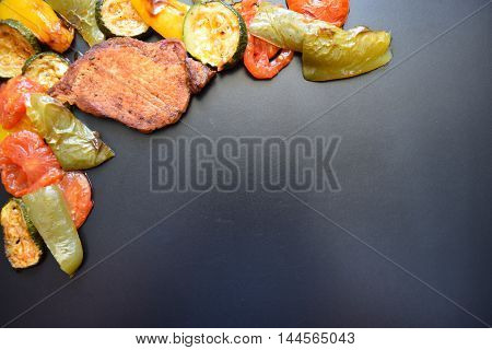 Grilled pork chop and vegetables on the grill