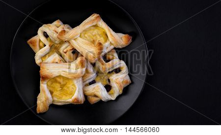 Danish Puff Pastry Flowers And Diamonds With Vanilla Pastry Cream On Black Background