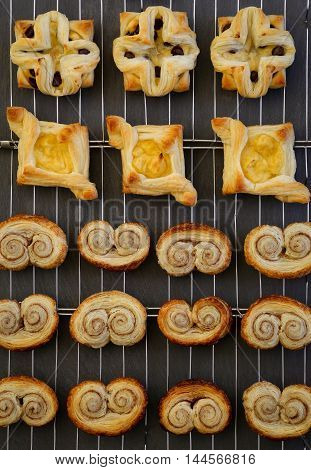 Homemade Gourmet Danish Puff Pastries Cooling On Wire Mesh Dark Background