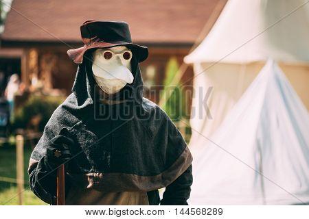 DUDUTKI, BELARUS - JULY 19, 2014: Plague doctor - participant of festival of medieval culture