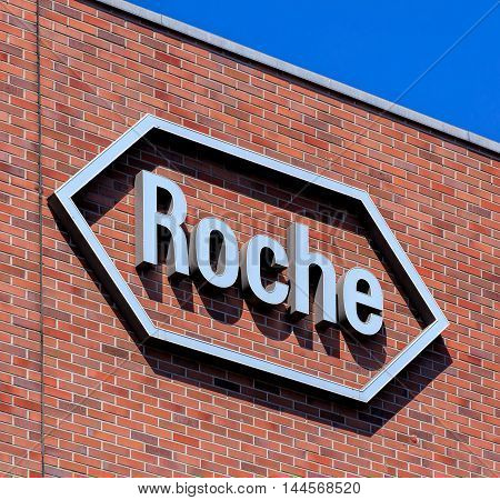 Basel, Switzerland - 27 August, 2016: Roche sign on the wall of an office building. Roche Holding AG operates in the pharmaceuticals and diagnostics businesses in Europe, North America and Asia.