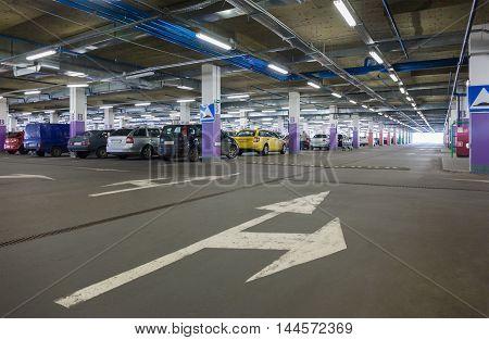 A subterranean car park in a shopping mall