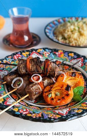 Balti Lamb Cooked With Yoghurt And Spices, Caramom Dried Apricots, Served Boiled Bulgur