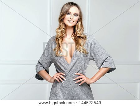 Blonde Fashionable Woman Posing In Studio.