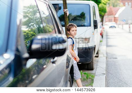Little 7 Years Old Boy During His Road To School.
