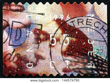 NETHERLANDS - CIRCA 1996: a stamp printed in Netherlands shows Mouth Two Faces Christmas circa 1996