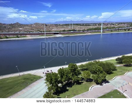Bird-eye view at Sail River Lake toward northern Phoenix mountain range Tempe AZ.