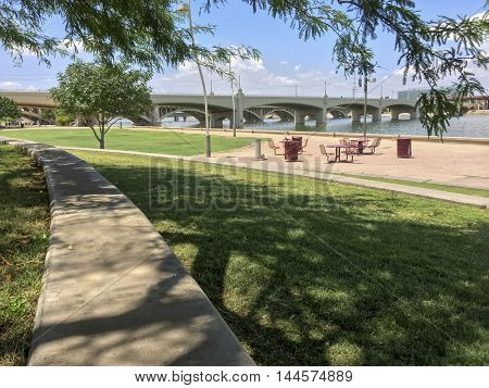 Historic Mill Avenue Bridge over Sail River Lake in city of Tempe AZ.