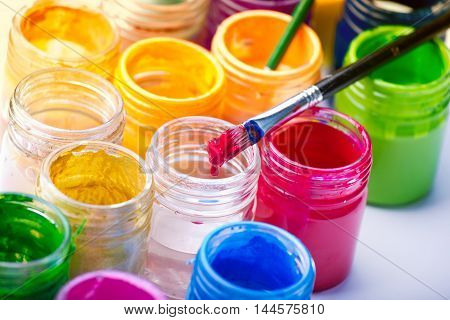 Painting Brush And Colors In Jars