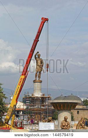 SKOPJE MACEDONIA - SEPTEMBER 17: Erecting Philip II Monument in Skopje on SEPTEMBER 17 2012. Philip II Macedon Sculpture Construction Site With Crane in Skopje Macedonia.