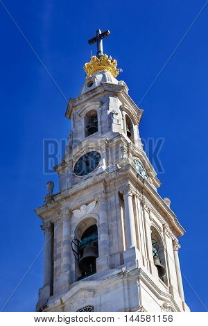 Basilica of Lady of Rosary Bell Tower Stone Angels Fatima Portugal. Church created on site where three Portuguese Shepherd children saw Virgin Mary of the Rosary. Basilica created in 1953.