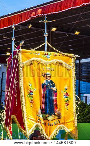 FATIMA, PORTUGAL - MAY 11, 2014 Believers Banners May 13 Mary Appearance Day Basilica of Lady of Rosary Fatima Portugal. Church created on site where three Portuguese Shepherd children saw Virgin Mary of the Rosary. May 13th day Virgin Mary appeared to th