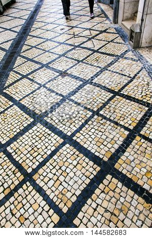 Black White Tiles Portuguese Symbol Medieval City Coimbra Portugal. All streets in Portugguese cities and former Portuguese colonies such as Brazil and Macao have these black and white street tiles.