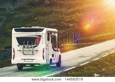 RV Camper Traveling. Recreational Vehicle on the Mountain Road. Wilderness Getaway.