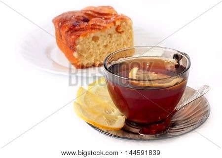 sweet baked pie and tea with lemon