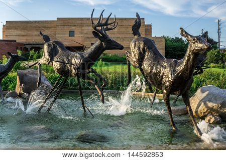 Indianapolis Indina USA - Aug. 2016. Deer sculptures in the fountain outside of the Eiteljorg Museum in downtown Indianapolis IN