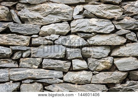 Stone wall in close up viewdetail texture of stone wall.