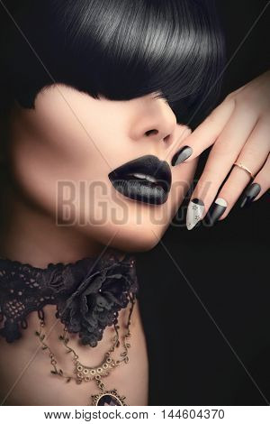 High Fashion Model Girl Portrait with Trendy gothic Black Hair style, Make up, dark Manicure and accessories. Halloween Vampire Woman portrait with black matte lips, fringe hairstyle, choker