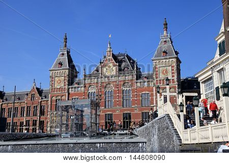 AMSTERDAM, NETHERLANDS - MAY 6, 2016:Amsterdam Central Train Station in Amsterdam, Netherlands . Every day 250000 go through Amsterdam's Central Station.