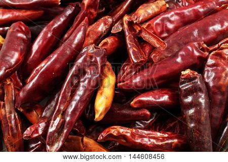 A close up image of dried red chilis