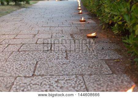 pedestrian walkway decorated with candles in the evening