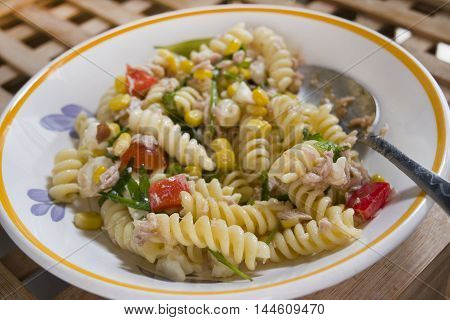 vegetarian salad of pasta with variety of vegetables