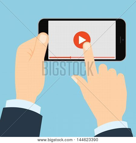 Smartphone with play button. Hands holding phone and touching play button. Concept of video, audio, internet and games.