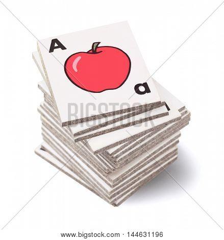 Stack of Preschool Alphabet Teaching Cards on White Background