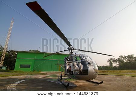 Helicopter parked at the helipad with sky