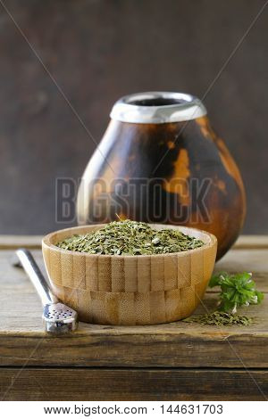 Traditional yerba mate tea in calabash mug and bombilla