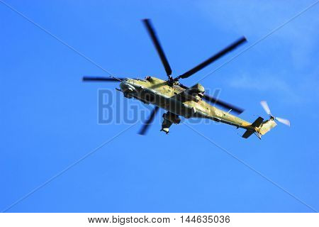 Syzran Russia - August 24 2016. military helicopter Russian MI-24 weapons performs training patrols in a given area