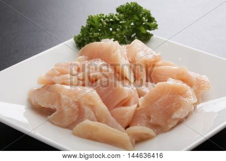 Fresh raw above Mino stomach meat with herbs on white platter