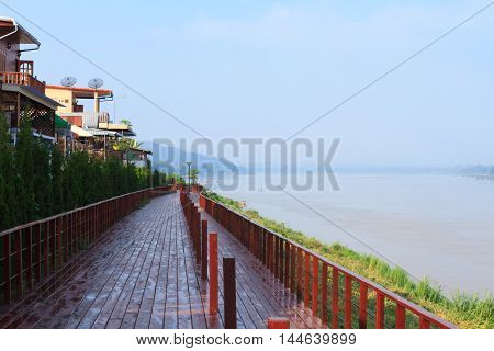 A boardwalk next to Mekong river in the morning at a small town named Chiang Khan Thailand.