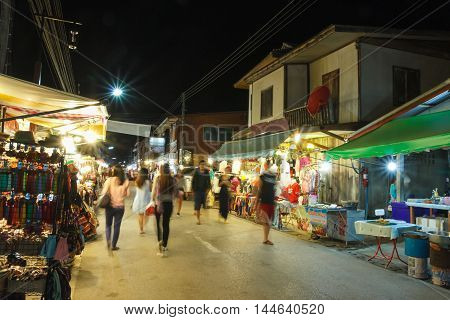 CHIANG KHAN THAILAND - DECEMBER 16: Chiang Khan's walking street at night with unidentified tourists on December 16 2015 in Chiang Khan Thailand.