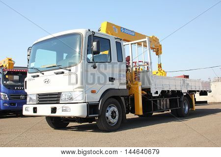 Great white truck crane standing on a construction site - RUSSIA MOSKOW - MAY 14 2016