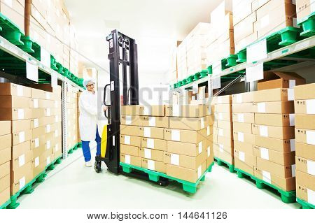 warehouse worker with stacker