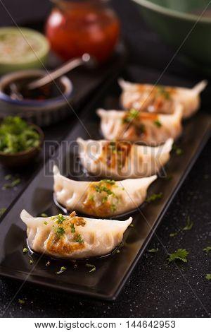 Seafood wonton in Japanese style on black platter
