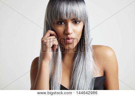 Black Woman With Grey Hair Sending A Kiss