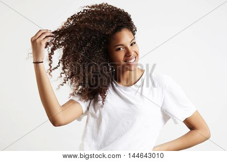 Black Woman With Afro Hair Touches Her Curly Hair
