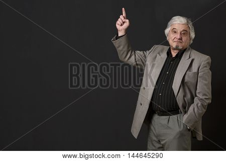 Professor man of university or colleage looking at camera and pointing about ner theory, concept or prove isolated on black background in studio.