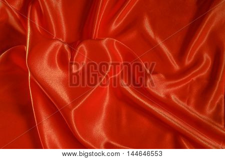 Texture red nacre satin cloth with the image of heart