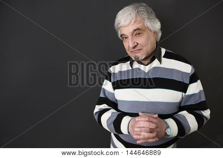 Portrait of handsome professor man of university or colleage isolated on black background. Teacger looking at camera in studio.